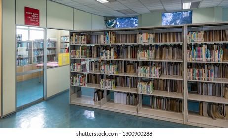 Lahad Datu, Sabah, Malaysia - April 24 2015: Interior view of the Sabah State Library, Lahad Datu Branch (malay: Perpustakaan Negeri Sabah Cawangan Lahad Datu), showing the reading tables and book she