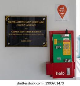 Lahad Datu, Sabah, Malaysia - April 24 2015: Pay phone outside of the building of Sabah State Library, Lahad Datu Branch (malay: Perpustakaan Negeri Sabah Cawangan Lahad Datu)