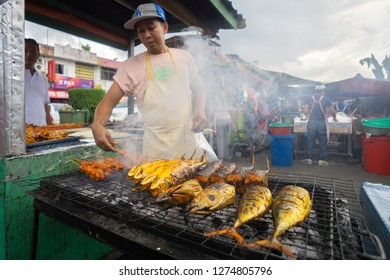 Lahad Datu Sabah Malaysia - Jul 17, 2017 : Street food vendor selling grilled food at night market stall in Lahad Datu Sabah. Night market eatery is popular among local and tourist in Malaysia.