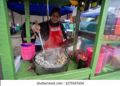 Lahad Datu Sabah Malaysia - Jul 17, 2017 : Muslim woman food vendor preparing dish called Bakso at Lahad Datu night market. The famous dish is originated from Indonesia.
