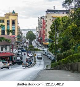 Lahad Datu, Sabah, Malaysia - May 23 2014: Downtown Lahad Datu. Left side yellow building is United Sabah Islamic Association (malay: Wisma USIA)