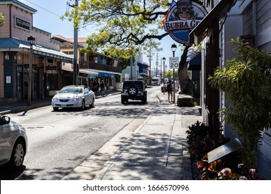 Lahaina, Hawaii/USA-February 25, 2020: Front Street in Old Town Lahaina, showing Bubba Gump Shrimp restaurant, and other store fronts in the popular tourist district. Illustrative Editorial