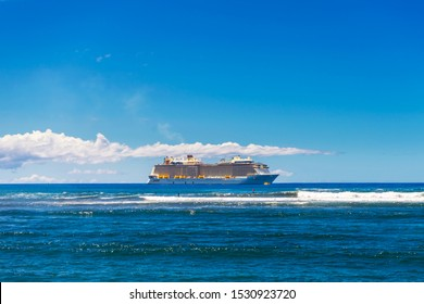 Lahaina, HI / USA – September 27, 2019: Royal Caribbean's Ovation of the Seas is docked off the coast of Maui at Lahaina, Hawaii.