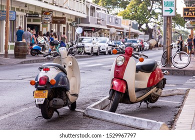 Lahaina, Maui, Hawaii \ USA - 01 August 2019: Two Honda Metropolitan II scooters parked on a busy tourists  street in a city downtown