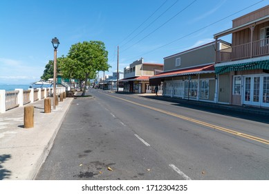 LAHAINA, MAUI, HAWAII / USA - APRIL 22, 2020:  Popular historic travel and tourism destination, Front Street in Lahaina, Hawaii, is closed for business during the Covid-19 coronavirus pandemic.