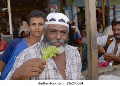 LAHIJ, YEMEN - SEPTEMBER 15, 2006: Unidentified man sells khat (Catha edulis) at the local market in Lahij, Yemen.