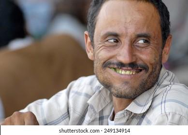 LAHIJ, YEMEN - SEPTEMBER 15, 2006: Unidentified man chews khat (Catha edulis) at the local market in Lahij, Yemen.