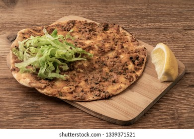 Lahmacun that is Turkish Pizza on a wooden table