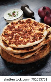 Lahmacun, turkish meat pizza with yogurt and onion