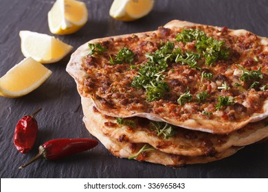 Lahmacun - Turkish pizza closeup on a stone table. horizontal