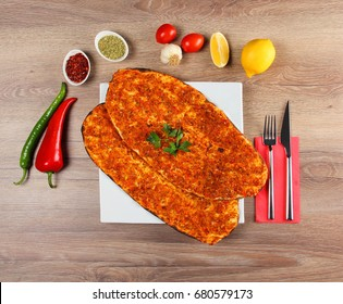 Lahmacun, very thin turkish pizza covered with seasoned minced meat and onions