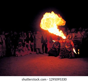 Lahore: dated 18/04/2001, Stuntman play with fire, A big crowd public watching him, The fire became like fire Dragon, district of Lahore Province of Punjab, Pakistan.