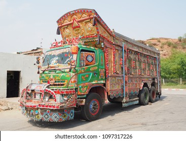 Lahore, Pakistan 1 May 2018 ; Traditional Colorful decoration truck parking at the street in front petrol station between the Islamabad to Karachi road.