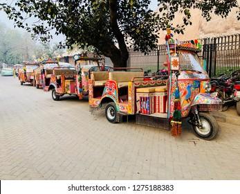 "Lahore, Pakistan - 28th January 2018: Colourful open top Tuk Tuk called ""Rangeela Rickshaw"", used for tourists"
