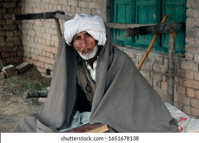 Lahore, Pakistan - 3/24/2019: Pic of a bearded old refugee from a rural area of south east asia.