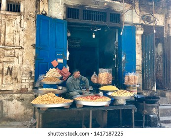 Lahore, Pakistan - 3rd Feb 2019: Street view of downtown Lahore. Traditional vendors, urban life - depiction of rich cultural heritage.