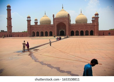 Lahore, Pakistan - 6/17/2019: Picture of Badshahi mosque built by Aurengzeb in 1673 to commemorate his military campaigns. The mosque can accommodate 10,000 worshippers in the prayer hall.