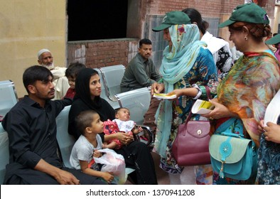 LAHORE, PAKISTAN - APR 15: Employees of (LWMC) are distributes pamphlet to people during Clean Green Lahore campaign, at Cantonment Railway Station on April 15, 2019 in Lahore.