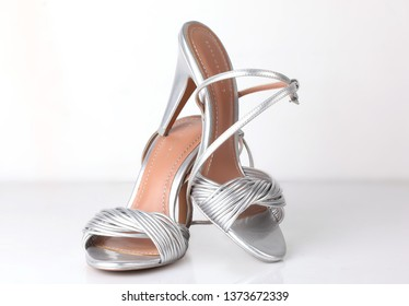 Lahore, Pakistan - Apr 18, 2019:Silver high heel women shoes isolated on white.