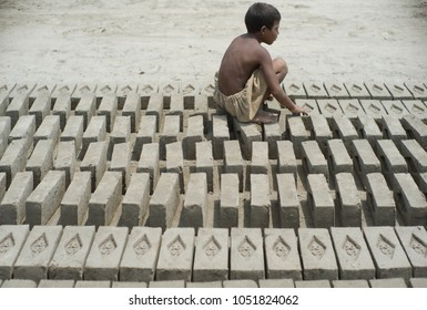 LAHORE, PAKISTAN- AUG 1 2012: An unidentified child work at a brick kiln on August 1 2012 in Lahore, Pakistan. Children are exploited in the brick kiln and they suffer from poor education.