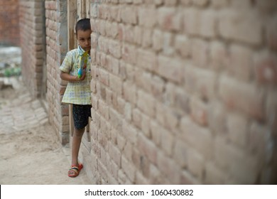 LAHORE, PAKISTAN- AUG 1 2012: Unidentified child work at a brick kiln on August 1 2012 in Lahore, Pakistan. Children are exploited in the brick kiln and they suffer from poor education.