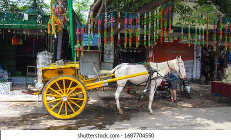 Lahore, Pakistan - August 18, 2019: Horse cart near taxali gate walled city waiting for passengers.