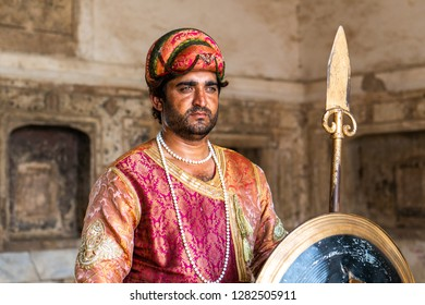 Lahore, Pakistan - August 5, 2018: Guard in historical costume of skirmisher in Lahore Fort in Pakistan. Illustrative editorial.