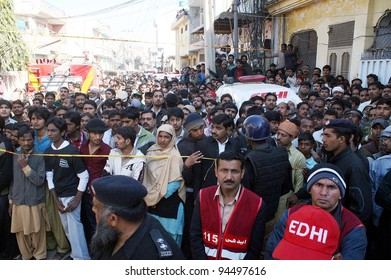 LAHORE, PAKISTAN - FEB 06: A huge number of people gather at the site of building collapse incident on February 06, 2012 in Lahore.
