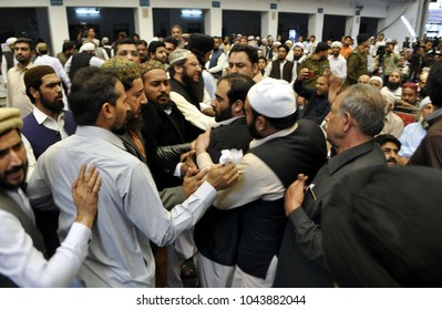 LAHORE, PAKISTAN - MAR 11: Security officials arrested a former seminary student hurled a shoe at Former Prime Minister PML-N on March 11, 2018 in Lahore.