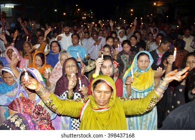 LAHORE, PAKISTAN - MAR 30:Christian Community are lighting candles while a protest against suicidal blast occurred at suicidal bomb blast of Gulshan-e-Iqbal Park on March 30, 2016 in Lahore.
