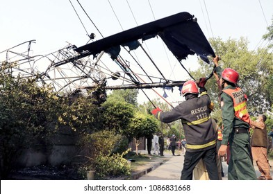 LAHORE, PAKISTAN - MAY 08: Rescue officials busy in rescue operation at site after a training plane crashed incident at Garden Town on May 08, 2018 in Lahore.