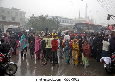 LAHORE, PAKISTAN - NOV 14: Residents of Green Town are holding protest demonstration against worst Sui gas load shedding, led by (PTI) leader Ejaz Chaudhry,  on November 14, 2017 in Lahore.