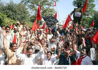 LAHORE, PAKISTAN - OCT 15: Supporters of Railways Workers Union shout slogans in favor of their demands during a protest demonstration at Lahore press club on October 15, 2011 in Lahore.