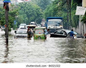 LAHORE, PAKISTAN - SEPT 08: Motorists pass through a flooded road during heavy downpour of Monsoon season in Lahore on Thursday, September 08, 2011 Lahore.