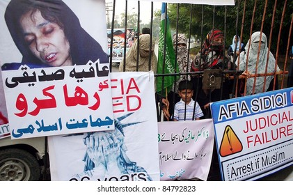 LAHORE, PAKISTAN - SEPT 16: Supporters of Jamat-e-Islami (JI) are protesting in favor of  Dr.Aafia Siddiqui during demonstration at American Centre in Lahore September 16, 2011.