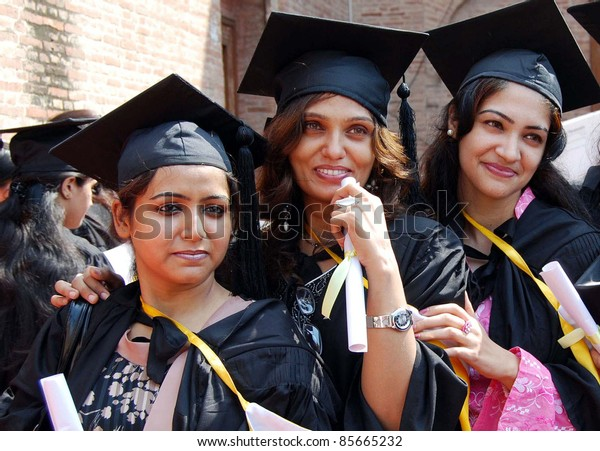 LAHORE, PAKISTAN - SEPT 29: A group photo of jubilant students with their degrees during the Annual Convocation Day ceremony of Government College for Women on September 29, 2011in Lahore.