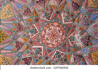 Lahore, Pakistan - September 5, 2018: Artistic historical ceiling with colorful decorations in Wazir Khan Mosque in Lahore, Pakistan. Illustrative editorial.