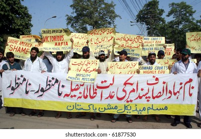 LAHORE-SEPT 25: Activists of Muslim Medical Mission chant slogans for the release of Dr.Aafia Siddiqui during demonstration to condemn the verdict against her, during protest outside Sept 25, 2010