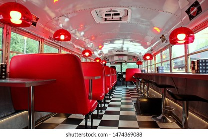 Lahti, Finland -08-08-2019: Interior of a restaurant made into old American school bus