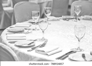 Laid table in restaurant. A photo of place settings laid out on a restaurant table