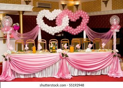 a laid wedding banquet table at a restaurant