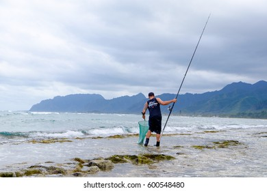 LAIE, HAWAII - FEBRUARY 24, 2017: Fisherman Jameson Humalon competes in a saltwater fishing tournament on Oahu targeting bonefish on the windward side of the island.