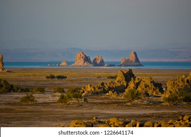 Lake Abhe volcanic area with chimney shape rock formations and sizzling water inside, Djibouti Ethiopian Border