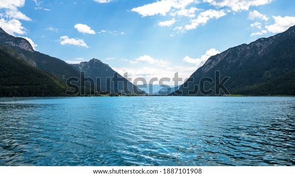 lake achen surrounded by mountains in Tirol Austria