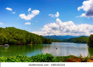 Lake activities, boating,marina seen from a moving train traveling through the Nantahala National forest.