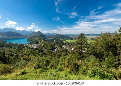 Lake Alpsee and Schwansee - Alpine lakes and the Hohenschwangau Village, Schwangau, Ostallgau district, Bavaria, Germany. It is located near the Neuschwanstein Castle and the Hohenschwangau Castle