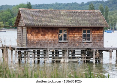 LAKE AMMERSEE, BAVARIA / GERMANY - May 21, 2018: Side view on a wooden boat house on stilts at Lake Ammersee.