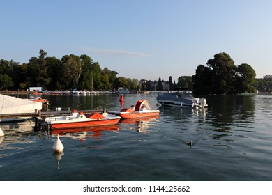 at the lake Annecy early in the summer, paddle boats and other boats waiting for tourists