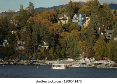 Lake Arrowhead, CA / USA - Oct. 20, 2018: The Arrowhead Queen scenic tour paddle boat is shown in front of homes and docks lining Lake Arrowhead on a late afternoon day.