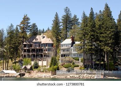 Lake Arrowhead, California - April 16, 2015: Mansion homes grace the shoreline of Lake Arrowhead, California, a popular mountain resort community within the San Bernardino National Forest.